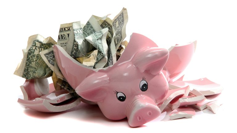 (<a href='http://www.bigstockphoto.com/image-30624272/stock-photo-broken-piggybank-with-dollar-notes'>Big Stock</a>)