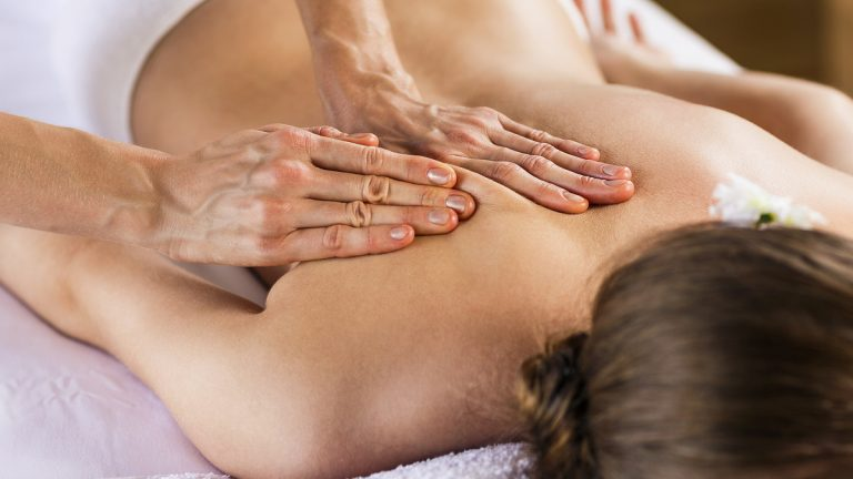 (Kotin/<a href='http://www.bigstockphoto.com/image-112333736/stock-photo-woman-enjoying-massage'>Big Stock Photo</a>)
