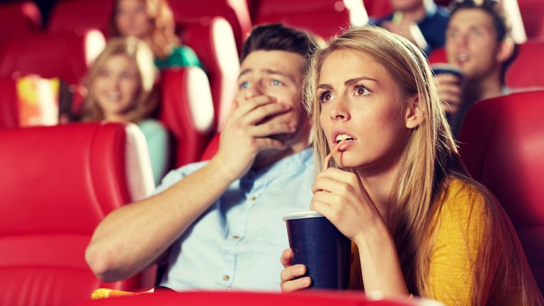 (<a href='http://www.bigstockphoto.com/image-109769333/stock-photo-cinema%2C-entertainment-and-people-concept-couple-drinking-soda-and-watching-horror%2C-drama-or-thriller-movie-in-theater'>Bigstockphoto.com</a>)