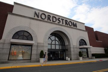 Shoppers walk past a Nordstrom department store in Paramus