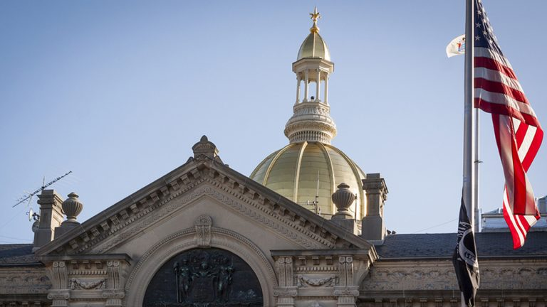 The American Flag flying in front of the New Jersey State House in Trenton (Bigstock/Glynnis Jones)