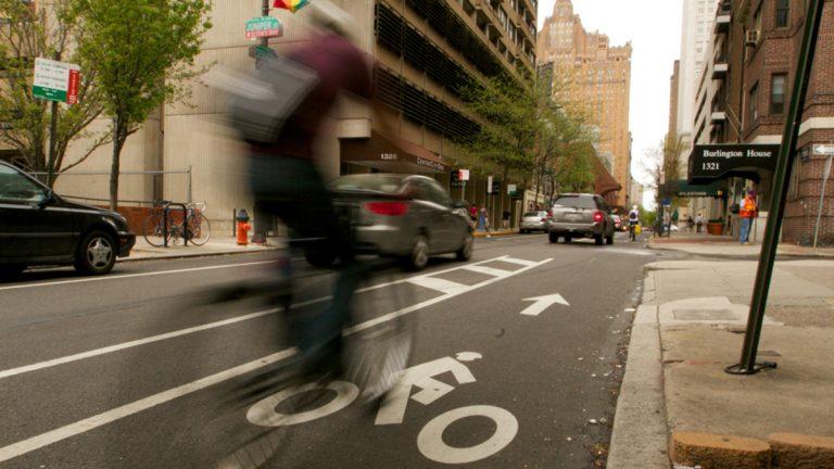 A cyclist heads west on Spruce Street toward Broad Street in Center City Philadelphia. (Nathaniel Hamilton/for NewsWorks)