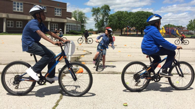 Students at Garfield Elementary School in Kansas City learn bicycle safety skills under the aegis of BikeWalkKC. (Alex Smith/for WHYY)
