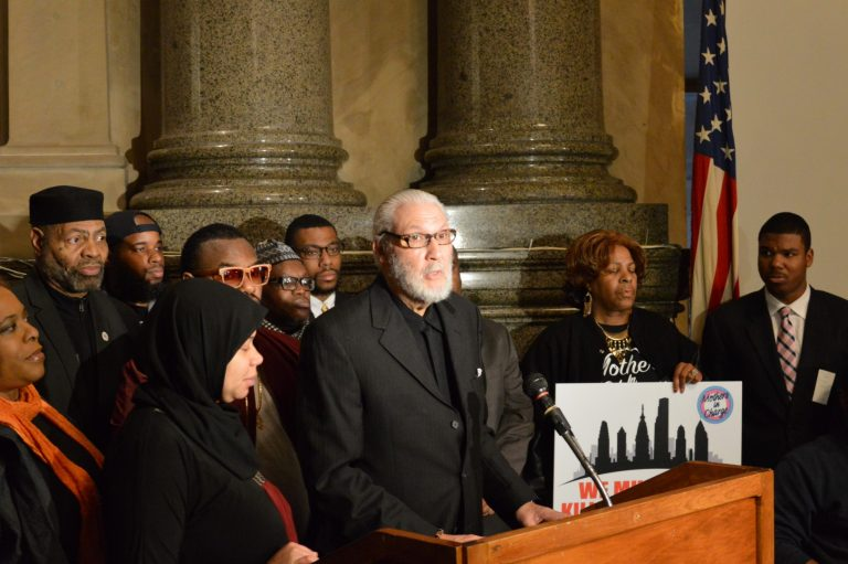Peace activists speak out at City Hall Wednesday about a plan to establish February as