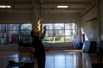 David Darwin demonstrates fire eating at a class on side show performance at the School of Circus Arts in Germantown. (Brad Larrison/for NewsWorks)