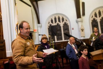 Local Developer Ken Weinstein addresses community members before touring the building attached to Mount Airy Presbyterian Church. (Brad Larrison/for NewsWorks)