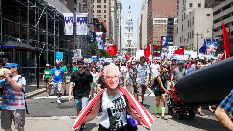 Pro-Bernie Sanders demonstrators march down South Broad Street during the Democratic National Convention. (Brad Larrison for NewsWorks)