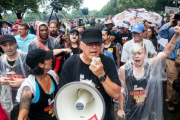 Members of the communist group Revolution Nothing Less march through FDR Park Thursday. (Brad Larrison for NewsWorks)