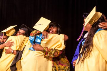 Former Germantown High Principal Margaret Mullen-Bavwidinsi greeted former students on stage. (Brad Larrison/for NewsWorks)