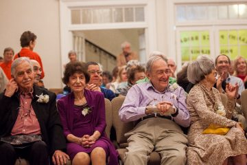 Sherman and Pauline Labovitz, Jerome and Ruth Balters and fellow honorees are applauded after videos chronicling their lives and activism was shown at Sunday's celebration. (Brad Larrison/for NewsWorks)