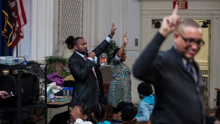 Roosevelt Principal Byron Ryan at an assembly on Thursday introducing the Positive Behavioral Intervention and Supports initiative to the school. (Brad Larrison/for NewsWorks)