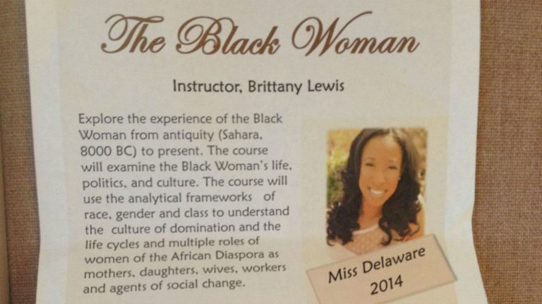 A flier for 'The Black Woman' at Wilmington University. (Avi Wolfman-Arent/for WHYY)