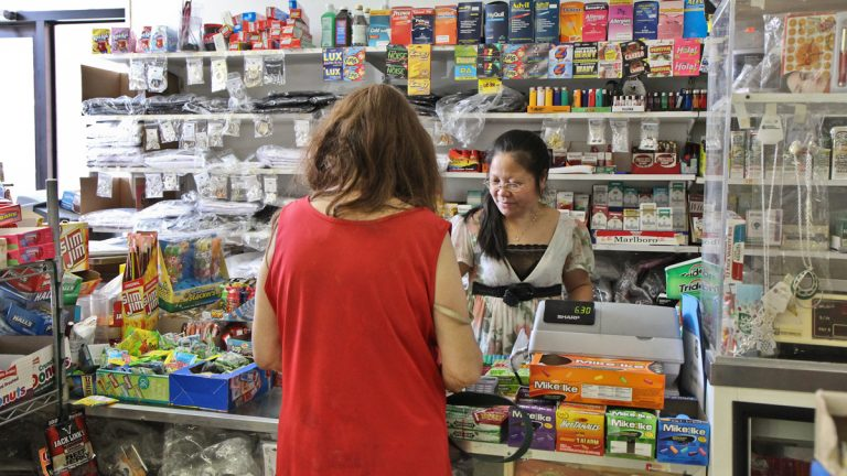 Chan Qyng, the owner of corner store New Matt's Market (1427 S 6th St., in Philadelphia), is always behind the counter. Gallup finds that Americans have a lot of confidence in small business as an American institution. (Kimberly Paynter/WHYY)