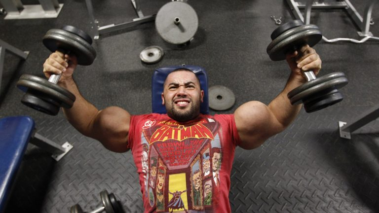 Body builder Moustafa Ismail lifts weights during his daily workout. Ismail has been given the title of world's biggest arms