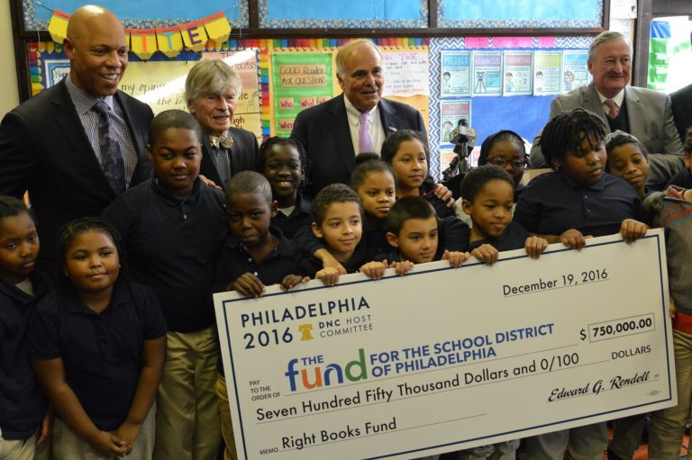 Officials with the Democratic National Committee and the School District of Philadelphia join students in celebrating the $750