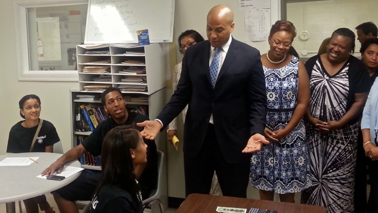 U.S. Sen. Cory Booker and Camden Mayor Dana Redd announce the award of a $1.1 million grant to the YouthBuild job training program. (Tom MacDonald/WHYY)
