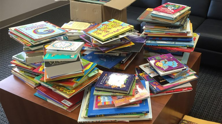 Hope Commission, an organization that helps incarcerated individuals return to society, received hundreds of books to donate to incarcerated parents and their children. (Zoe Read/WHYY)