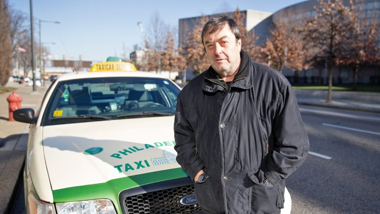 Boris Kautsky is manager and operator of CoachTrans, Inc., taxicab service in the Philadelphia area. He'd like to retire, but he says Uber has made that impossible for him. (Lindsay Lazarski/WHYY)