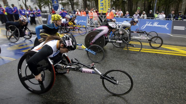 Competitors leave the start line in the women's wheelchair division of the Boston Marathon in Hopkinton, Mass. (AP Photo/Stephan Savoia)