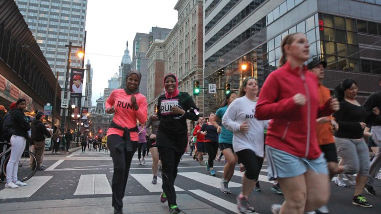 Philadelphia-area runners participate in an April 18, 2013, community run in support  of the victims of the Boston Marathon bombings. (Kimberly Paynter/WHYY, file)