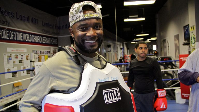 Veteran Wendell Chavis finds his joy at Joe Hand boxing gym, where he helps to train young fighters like Bryan Roque (right). (Emma Lee/WHYY)