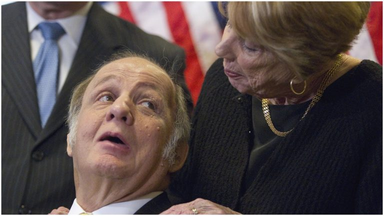 This March 30, 2011, file photo shows former White House press secretary James Brady looking at his wife Sarah Brady, during a news conference on Capitol Hill in Washington marking the 30th anniversary of the shooting. (AP Photo/Evan Vucci)
