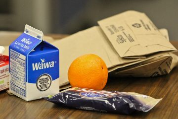 Student breakfast at Penn Wood Middle School consists of a carton of juice, carton of milk, a piece of fruit, and a grain. (Kimberly Paynter/WHYY)