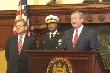 With City Controller Alan Butkovitz, left, and acting Fire Commissioner Derrick Sawyer at his side, Mayor Jim Kenney Thursday formally announces the end of the brownout policy for city fire stations. (Tom MacDonald/WHYY)