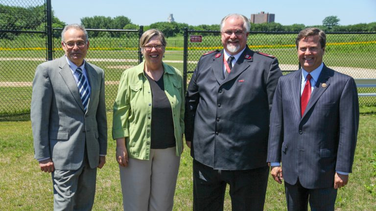 Officials (from left) Jim Harveson, director of Economic Development, Camden Redevelopment Agency, Judith A. Enck, EPA regional administrator, Salvation Army Maj. Paul Cain, and N.J. Congressman Donald Norcross announce funding Monday for brownfield cleanups in Camden. (Kimberly Paynter/WHYY)