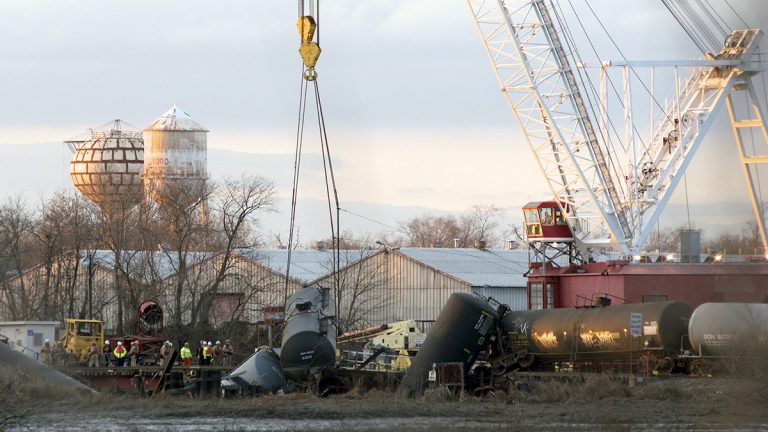 A crane lifts up a car at the derailment site in Paulsboro, N.J. (Bas Slabbers/for NewsWorks)