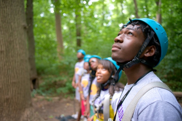 Students from MLK and GHS watch classmates on the ropes course as part of the Outward Bound program. (Bas Slabbers/for NewsWorks)