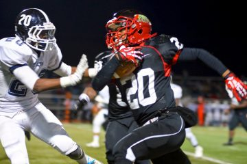 Imhotep's Nasir Bonner (with ball) helped his team blow out Springfield Twp. on Saturday night despite captain Khalif Hopkins-Bey's best efforts. (Bas Slabbers/for NewsWorks)