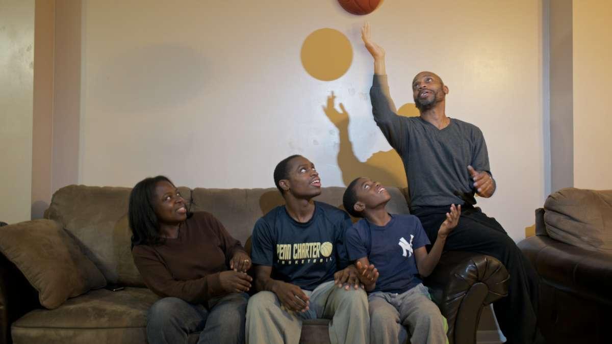 The Isaac family jokes around inside their South Philadelphia home. (Bas Slabbers/for NewsWorks)
