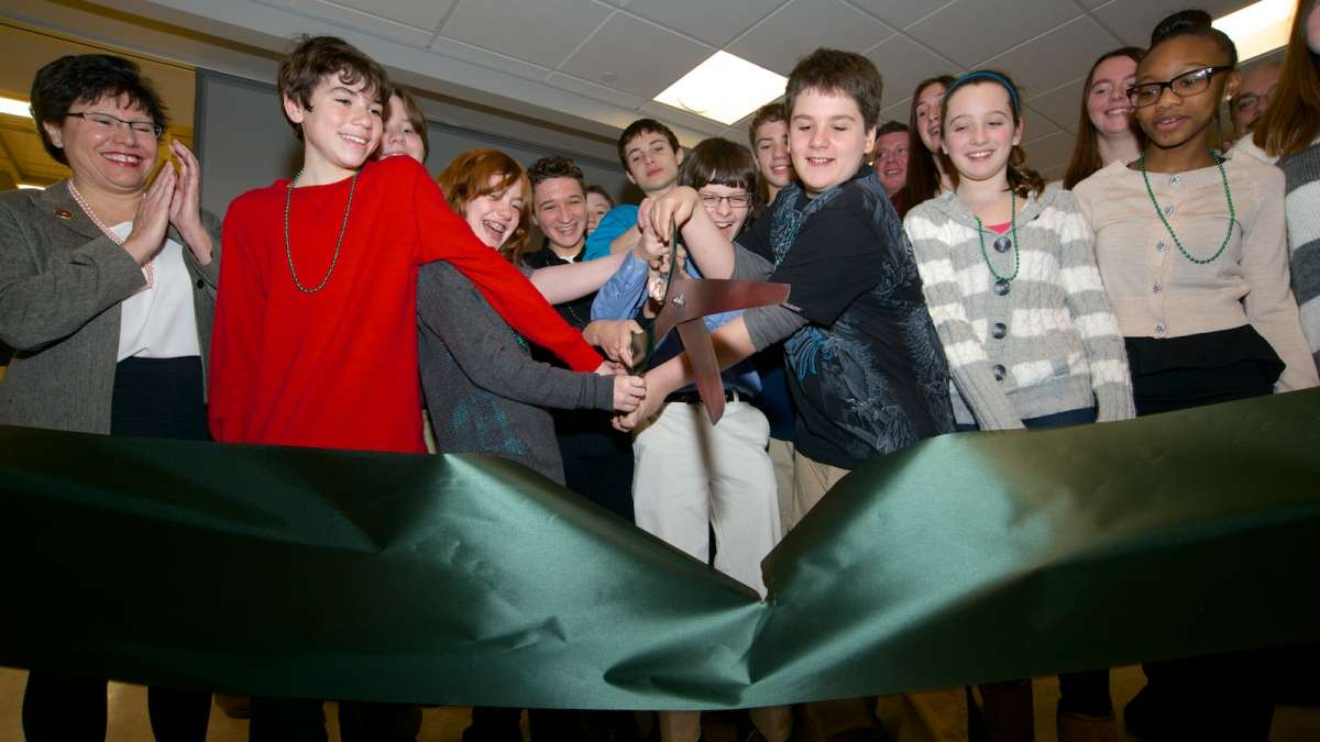 Students of the Green Woods Charter School cut the ribbon at their new facility on Monday. (Bas Slabbers/for NewsWorks)