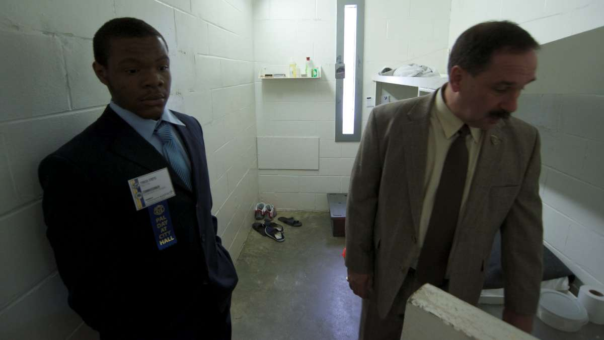 Tyreek Stotts and Prison Commissioner Louis Giorla inspect one of the two-inmate cells. There are currently an estimated 8,500 inmates being held within the correctional facility's 13 units. (Bas Slabbers/for NewsWorks)