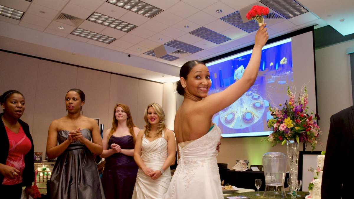 A bouquet is tossed into the crowd of future brides at Sunday's bridal-fashion show in Mt. Airy. (Bas Slabbers/for NewsWorks)