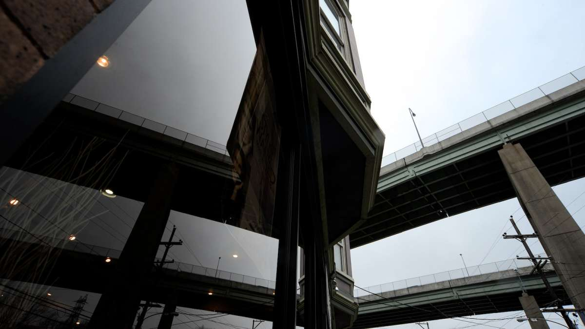 The Route 1 bridges, as seen reflected in the window of 4141 Ridge Ave. (Bas Slabbers/for NewsWorks)