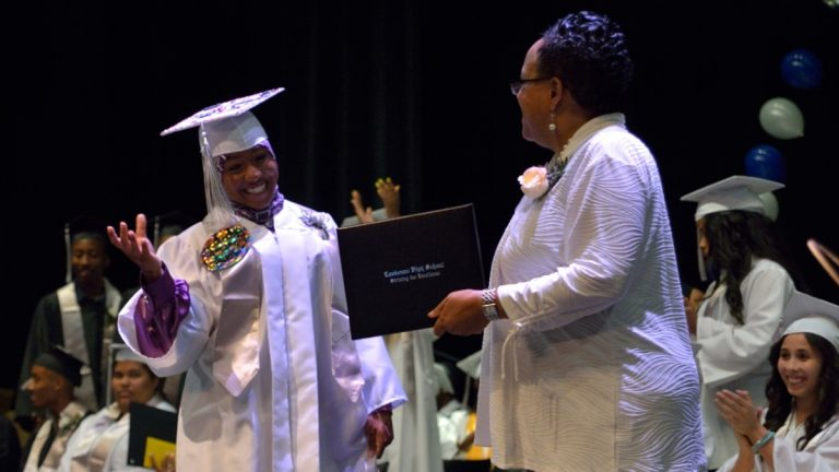 Lankenau High School students receive their diplomas at the 2014 commencement. Lankenau is one of five Philadelphia schools cited for making 'high progress' in state assessments. (Bas Slabbers/for NewsWorks)