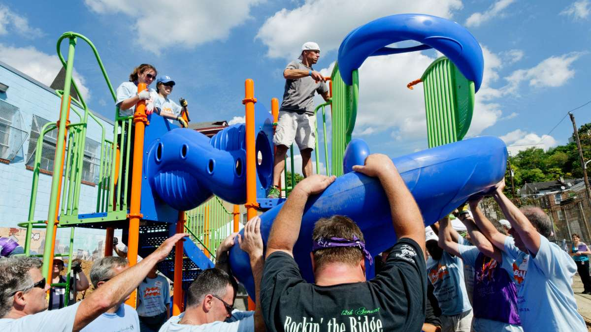 Volunteers come together to build a playground at Manayunk's North Light Community Center on Tuesday. (Bas Slabbers/for NewsWorks)