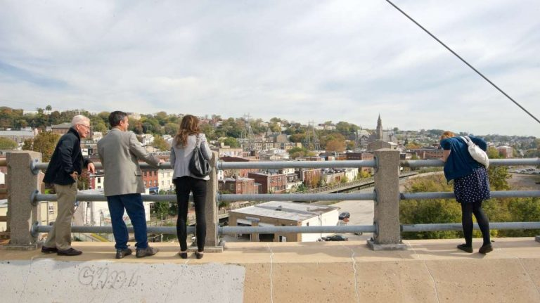 Checking out the view from atop the Manayunk Bridge Trail after Tuesday's ground-breaking ceremony. (Bas Slabbers/for NewsWorks)