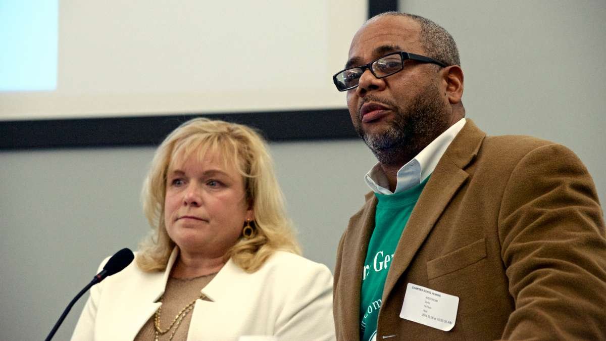 Julie Stapleton Carroll and Joe Budd present the plans for the Germantown Community Charter School Coalition to School District officials at a meeting in Dec. (Bas Slabbers/for NewsWorks)