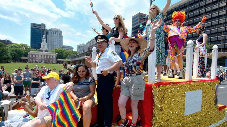 The 2025 Philly LGBT Pride grand marshal's float is shown passing by Independence Hall. (Baastian Slabbers for NewsWorks)