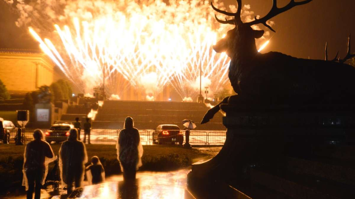 Rain and fog obscures most of the fireworks grande finale. (Bastiaan Slabbers for NewsWorks)
