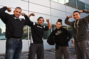 Steve's Club owner Steve Liberati with Camden CrossFit participants CJ Chaparro, Gabby Dominguez and Dominic Dominguez. (Kimberly Paynter/WHYY)