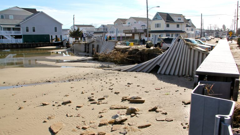 Last month's blizzard left a gaping hole in this West Wildwood bulkhead. The structures and dunes damaged during last month's storm leave Shore towns vulnerable. (Emma Lee/WHYY)