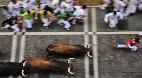 Revelers run on Estafeta St. in Pamplona northern Spain. Organizers plan to bring a domestic version to Berks County in June. (Alvaro Barrientos/AP Photo, file)