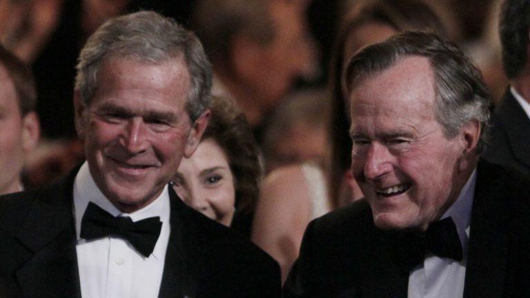 Former Presidents George H. W. Bush, right, and George W. Bush, left. (Carolyn Kaster/AP Photo, file)