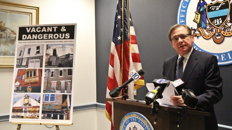 Philadelphia City Controller Alan Butkovitz speaks at a press conference Wednesday about vacant properties posing a danger in the city. (Kimberly Paynter/WHYY)