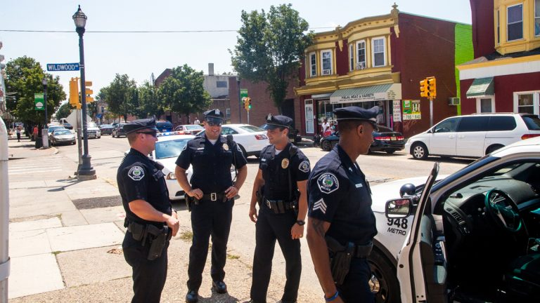 Officers stand on Haddon Avenue in Camden, New Jersey. (Brad Larrison/for NewsWorks)