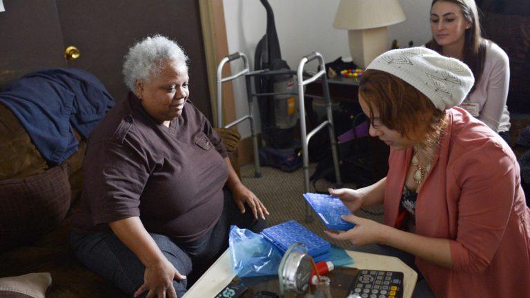 Members of the Camden Coalition team make a home visit in Camden in 2014. (Couresy of Lynsey Addario/Camden Coalition)